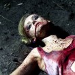 Bloody dead woman lying on the ground — Stock Photo #29656171