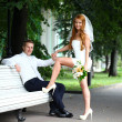 Stock Photo: Young bride and groom in summer park