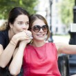Happy young women taking pictures on your phone — Foto Stock