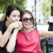 Happy young women taking pictures on your phone — Stock Photo