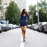 Beautiful young woman walking on the street — Stock Photo #31017425