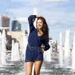 Young sexy woman in a city fountain — Stock Photo