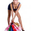 Happy young adult woman with colored bags — Lizenzfreies Foto