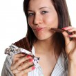 Girl eating a chocolate  — Stock Photo