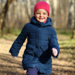 Little girl in a white knitted hat autumn — Stock Photo #34827007