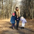 Mother and her little girls outdoors session — Stockfoto