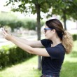 Young woman taking pictures on your phone — Foto de Stock