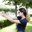 Young woman taking pictures on your phone — Stok fotoğraf