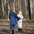 Two sisters in autumn park — Stock Photo #34894205