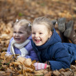 Two sisters in autumn park — Stock Photo #34894245