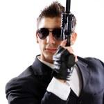 Men in black suit holding gun — Stock Photo