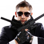 Men in black suit holding gun — Stock Photo #37362937