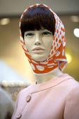 Portrait of female mannequin in orange scarf — Stock Photo