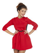 Beautiful young female in red dress standing posing — Stock Photo