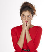 Young woman is holding her face in astonishment — Stock Photo