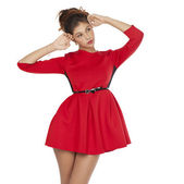 Beautiful young female in red dress standing posing — Stock fotografie