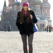 Stock Photo: Young woman walking on the Red Square in Moscow