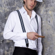 One man in shirt and white hat — Stock Photo #40003841