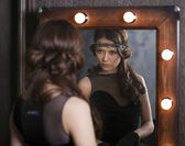 Mirror reflection of a young caucasian woman — Stock Photo