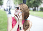 Beautiful young blonde woman in sunglasses — Stock Photo