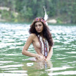 Young beautiful woman bathes in lake — Stock Photo #40403917