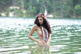 Young beautiful woman bathes in lake — Stock Photo