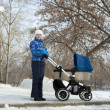 Mother with baby stroller for newborn — Stock Photo #41625811