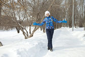 Happy woman walking in winter park — Stock Photo
