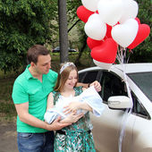 Happy young new couple parent with baby boy — Стоковое фото