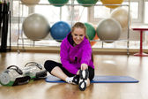 Young woman in a sports hall — Stock Photo
