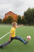 Athletic boy on the football field — Stock Photo