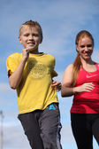 Athletic mother and son engaged in fitness — Stock Photo