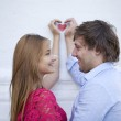 Couple in love and a symbol of love - red heart — Stock Photo #46334963
