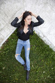 Sexy woman in leather jacket and blue jeans — Stock Photo