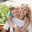Happy mother and her son standing outside — Stock Photo #47384177