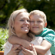 Happy mother and her son standing outside — Stock Photo #47384209