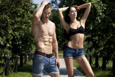 Beautiful sexy young couple in blue jeans — Stock Photo