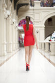 Young beautiful woman in red dress  — Foto Stock