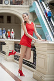 Young beautiful woman in red dress  — Stockfoto