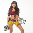 Sexy young woman shows construction tools — Stock Photo #48424207