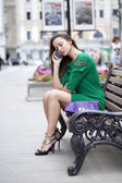 Young woman sits on a bench  — Stock Photo