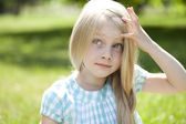 Portrait of a beautiful blonde little girl three years — Stock Photo