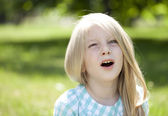 Portrait of a beautiful blonde little girl three years — 图库照片