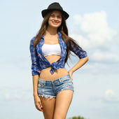 Happy woman in jeans shorts on road — Stock Photo