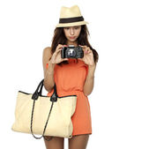 Happy young woman using a camera to take photo — Foto de Stock