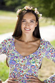 Beautiful young woman in colorful dress — Stock Photo