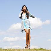 Beautiful young woman in blue sexy dress — Foto de Stock
