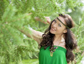 Beautiful young woman in green dress — Stock Photo