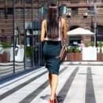 Young beautiful woman walking away — Stock Photo #50807689