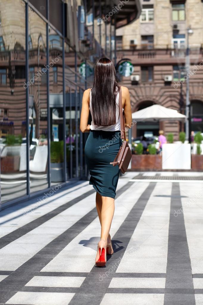 Young beautiful woman walking away — Stock Photo © arkusha ...